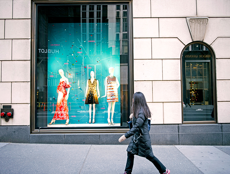 Image of lady walking across a retail boutique